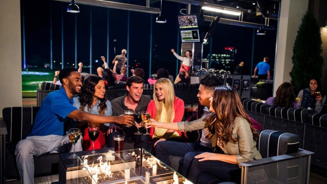Topgolf is at once old-fashioned and modern -- and the setting is loud and lively, not your typical back-nine fare.