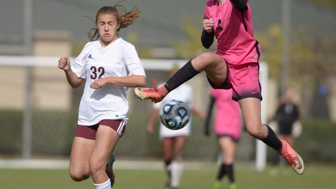 Houston's Kate Handel, right, takes the ball from a Collierville defender as Houston wins 1-0 in the Class AAA state soccer championship Saturday at Richard Siegel Soccer Complex in Murfreesboro, Tenn.
