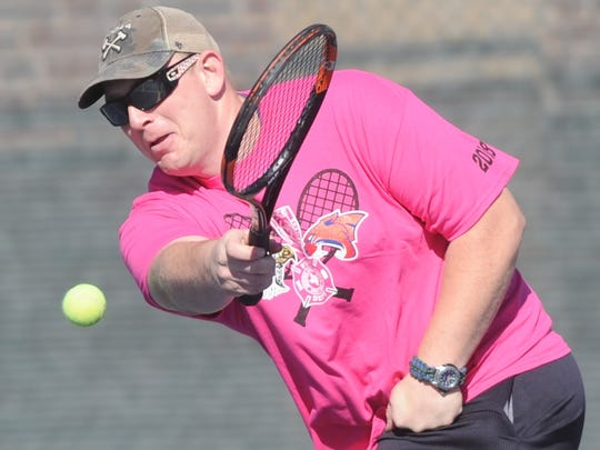Abilene firefighter Brent Holsenbeck returns a shot during his doubles match against fellow firefighter Jonathan Bowen and Abilene High sophomore McKenna Bryan. Holsenbeck teamed up with AHS sophomore Katherine Morris at the AHS-Cooper Hurricane Harvey relief fundraiser Saturday, Jan. 27, 2018 at Rose Park Tennis Center.
