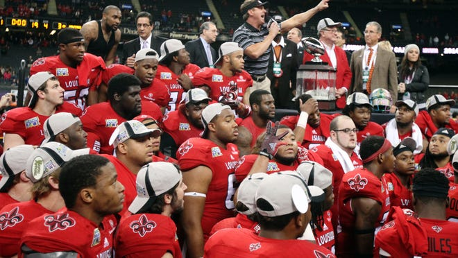UL head coach Mark Hudspeth speaks to fans after the Cajuns' 16-3 win over Nevada in the R+L Carriers New Orleans Bowl Saturday at the Mercedes-Benz Superdome.