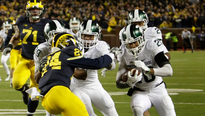 Michigan State's Jalen Watts-Jackson runs the ball down the sideline for a 38-yard touchdown on a muffed punt to give Michigan State a shocking 27-23 win over Michigan on Oct. 17, 2015 at Michigan Stadium.