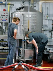 Zachary Allard, lead brewer, and Derek Armstrong, head