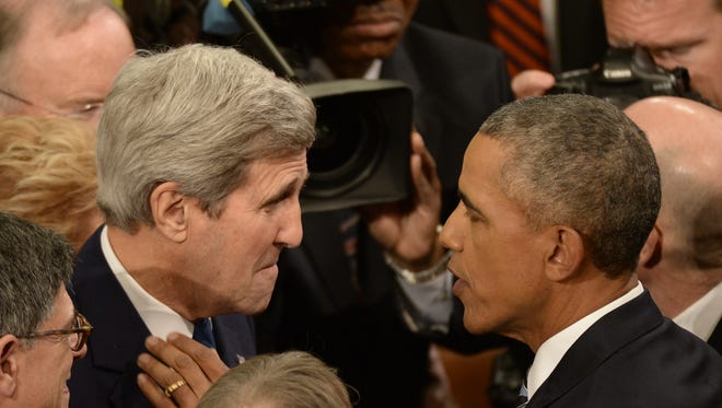 Secretary of State John Kerry greets President Obama after the State of the Union address Tuesday.
