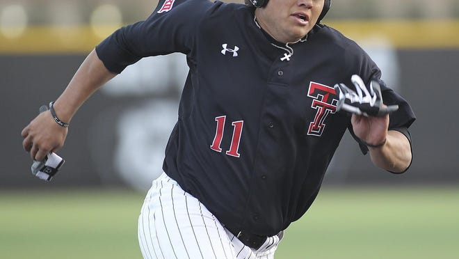 Texas Tech first baseman Cameron Warren (11) led the Big 12 with 86 runs batted in last year. Warren was among three Tech players recently released with minor-league baseball unlikely to play this season.