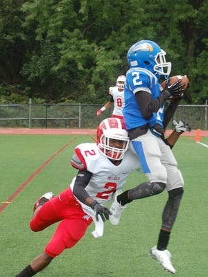 Paul VI receiver Lonnie Moore pulls in a 12-yard touchdown during the first half of Saturday's game.