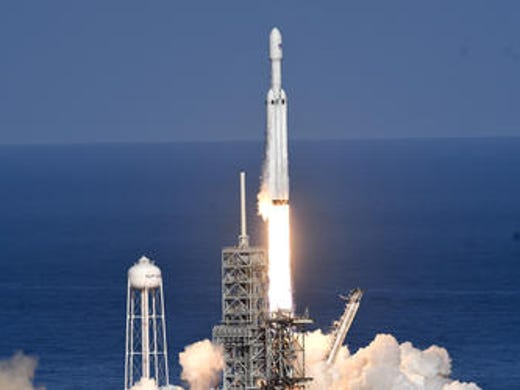 SpaceX's newest rocket , the Falcon Heavy takes off
