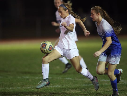 Maclay's Katelyn Dessi dribbles the ball down field