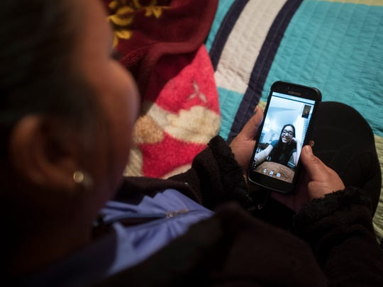 Guadalupe Garcia de Rayos, 36, video chats with her kids from her room in Acambaro, Mexico, over 1,400 miles from her family in Mesa, Arizona. Garcia de Rayos was deported to Mexico on Feb. 9, 2017, the day after she had gone to the Phoenix offices of Immigration and Customs Enforcement for what until then had been a routine check-in.