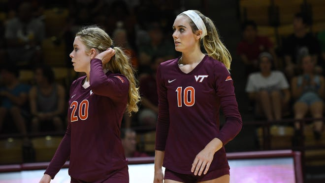 Virginia Tech freshman setter/defensive specialist Abby McKinzie (20) and senior outside hitter Amanda McKinzie get ready during a match against the University of Maryland, Baltimore County (UMBC) on Aug. 27.