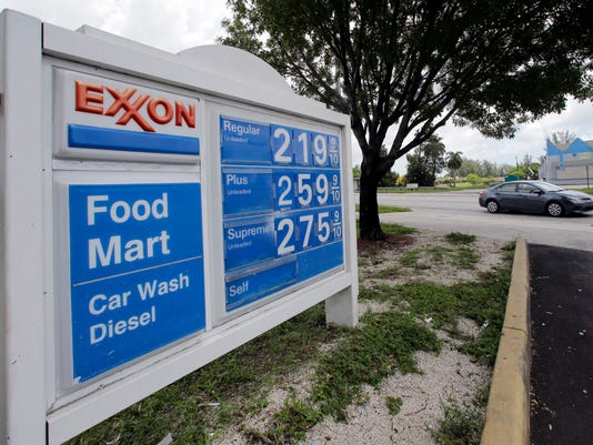 AP EARNS EXXON MOBIL F A USA FL