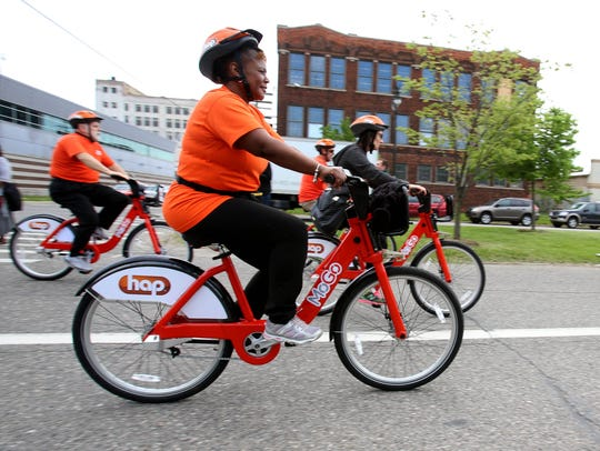 People ride the MoGo bikes in the New Center area of
