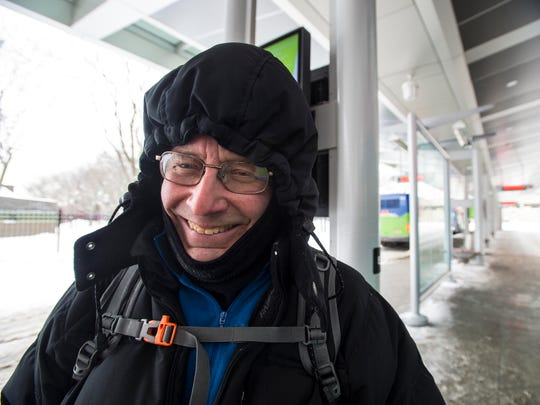 Brian Rioux of Burlington waits for his bus in sub-zero temperatures at the Downtown Transit Center in Burlington on Friday, January 5, 2018.