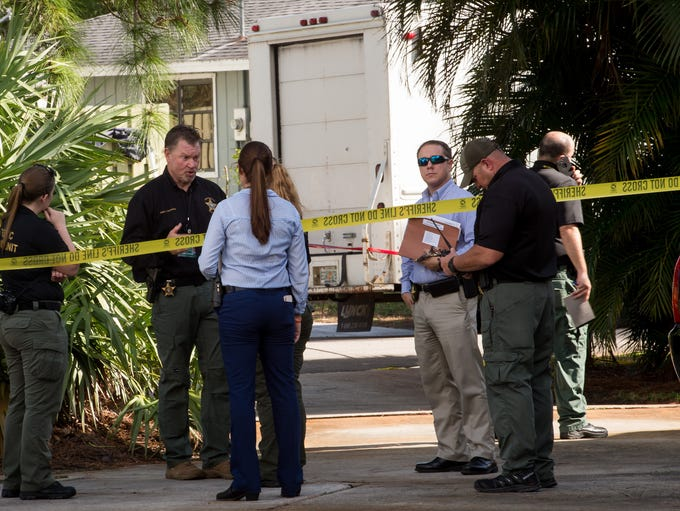 Martin County Sheriff's Office personnel work at the