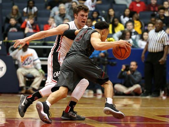 Oak Hills' Nick Deifel defends on Wayne's Darius Quisenberry