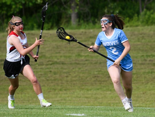South Burlington's Kate Hall (2) runs with the ball during a high school girls lacrosse playoff game last year.