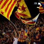 FC Barcelona' fans hold flags that symbolize Catalonia's independence, during a recent La Liga match at Camp Nou.