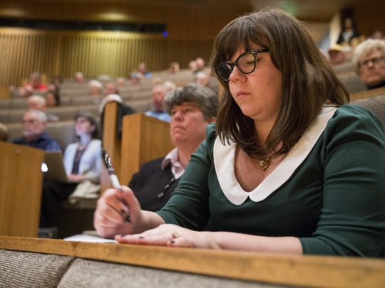 In a 2015 file photo, Katie Blair, with Freedom Indiana, writes down a comment card during a forum called Rights for All that serves as a place to debate the issues over Indiana's consideration of RFRA policy, Shelton Auditorium Christian Theological Seminary, Indianapolis.