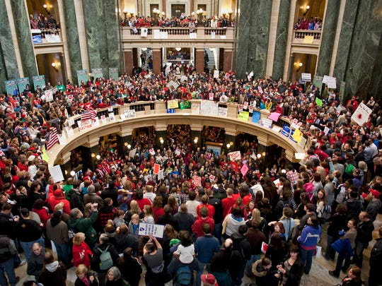 Thousands pack inside of the state Capital in Madison in February 2011 to protest Gov. Scott Walker's Act 10, which placed severe limits on public unions.