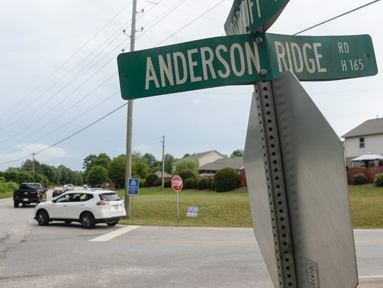 A car turns off of Anderson Ridge Road back on to Woodruff