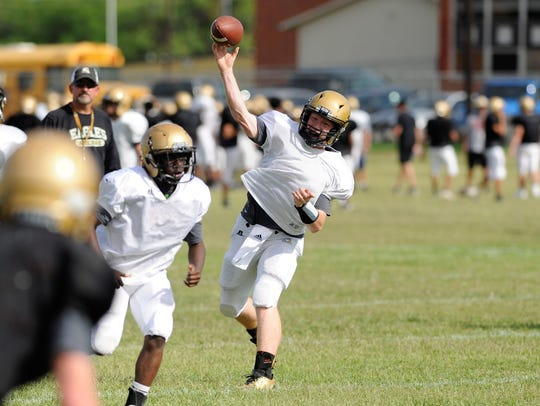 Abilene High quarterback Eric Abbe throws a pass during an offensive drill at the Eagles' first spring practice.