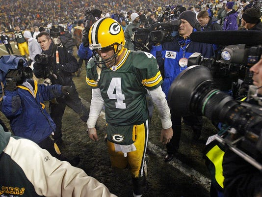 "FILE - In this Jan. 9, 2005, file phoot,  Green Bay Packers quarterback Brett Favre holds his head down as he walks off the field following the NFC wild-card game against the Minnesota Vikings in Green Bay, Wis. Favre says he might have had ""thousands"" of concussions during his Hall of Fame career. The three-time NFL MVP who played from 1992-2010 and was known for his aggressive approach to football said Thursday, April 12 2018 on NBC's ""Megyn Kelly Today"" that he is experiencing short-term memory issues. (AP Photo/Darren Hauck, File)"