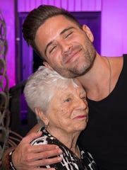 """Barbara """"Mother"""" Hubbard gets a warm embrace from Nashville recording artist Brennin Hunt Thursday evening at the New Mexico Heritage Farm and Ranch Museum at a celebration of her 90th birthday."""