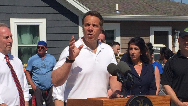 Gov. Andrew Cuomo speaks at a news briefing in Greece.
