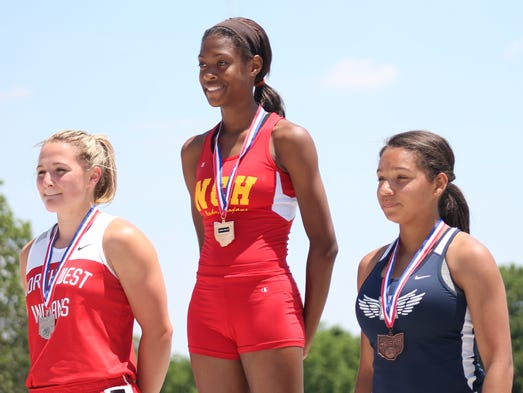 North College Hill junior Jazmin Smith stands atop the podium as the Division II state champion in the 100 hurdles.
