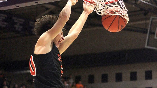 Thomas Kurowski of Sturgis dunks a ball against Three Rivers in a game last season. On Sunday, Kurowski committed to play at the University of Chicago.