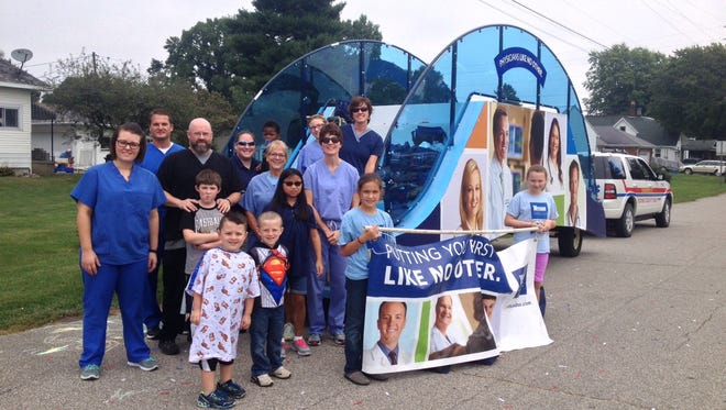 Witham Health Services employees participate in a community parade