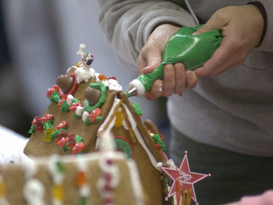 Gather in the kitchen to make a gingerbread house this