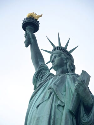The Statue of Liberty, designed and built in France, was assembled on Bedloe's Island in 1886, six years before Ellis Island opened nearby as an immigrant processing facility. (Chris Reynolds/Los Angeles Times/TNS)