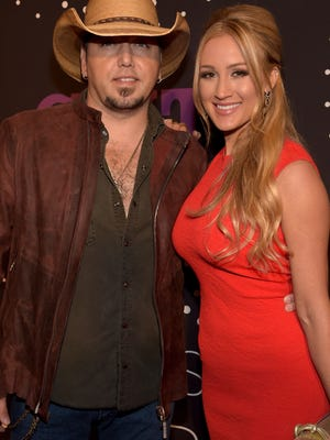 Jason Aldean and Brittany Kerr attend the 2014 CMT Artists Of The Year at the Schermerhorn Symphony Center on December 2, 2014 in Nashville, Tennessee.