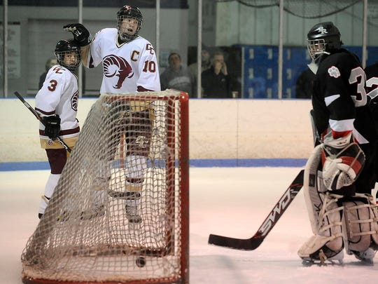 John Gaudreau, left, and Buddy Robinson, right, were teammates at Gloucester Catholic in their high school days and teamed up for a Calgary Flames goal Saturday night.