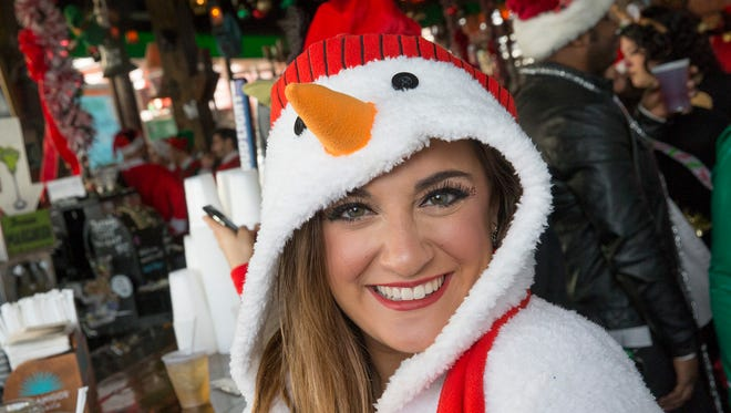 Rebecca Rosenfeld of Marlboro showed up as a snow woman for Asbury Park's 2016 Santa Con starting at Johnny Macs on Main St.  and it eventually spread, with Santas hitting the bars all over town.