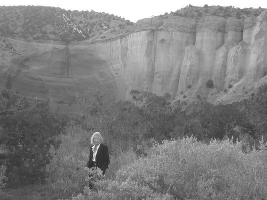 Actor Deborah Blanche takes a walk near Georgia O'Keeffe's