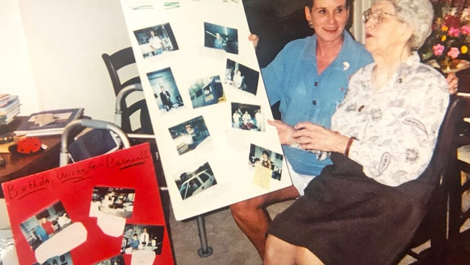 Weesie Fickling (left) shows former Barnwell resident Annie Scoville poster boards featuring photos of her Barnwell friends during a visit on Oct. 14, 1997 in Rock Hill to celebrate Scoville's 92nd birthday.