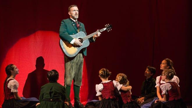 """Indiana native Ben Davis as Captain Georg von Trapp with the von Trapp Children in """"The Sound of  Music."""""""