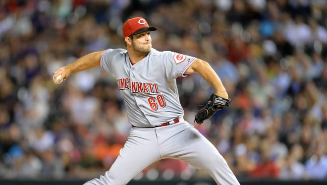 Cincinnati Reds relief pitcher J.J. Hoover (60) delivers a pitch in the sixth inning against the Colorado Rockies at Coors Field. The Rockies defeated the Reds 7-3.