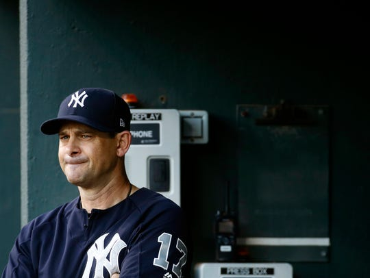 New York Yankees manager Aaron Boone stands in the