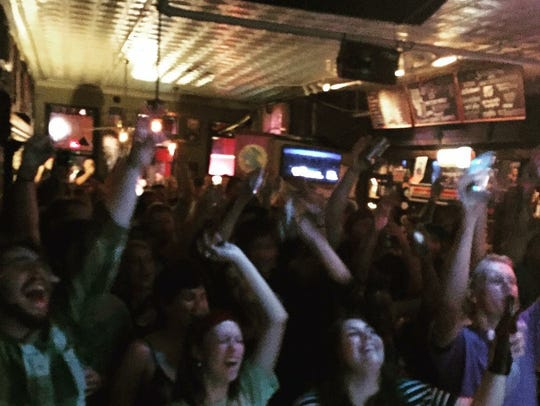 Fans cheer on Dirtfoot as they perform at Bear's on