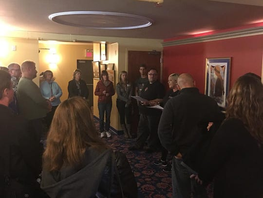 Ghost hunt patrons are briefed on what is next by lead