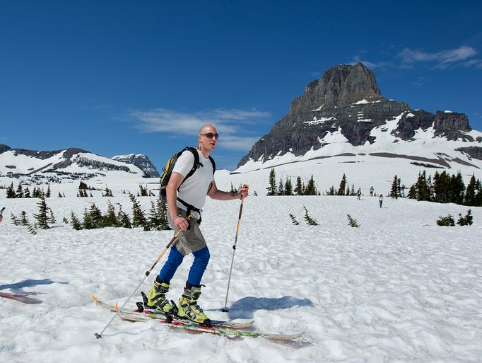 Steve Shea, left, and David Marx of Whitefish, ski at Logan Pass off of the Going-to-the-Sun Road in Glacier National Park Thursday, July 3, 2014, on the first full day the road was open to the public.