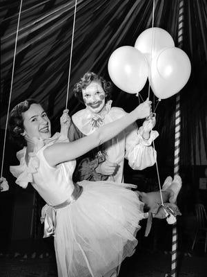 A circus theme prevailed at the Chi Omega lodge during sorority rush the first week of December 1950, with such daring performers as trapeze artist Ann Turner (left) of 1301 Agnes Place and the jovial clown Jean Arnold of 3569 Shirlwood. Rush week at Southwestern concluded with pledging rituals and open houses at each of the sorority houses.