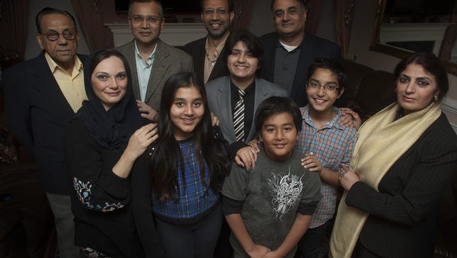 Members of the South Jersey Pakistani Society pose for a photo at one of their members home in Cherry Hill N.J., From left, Aqil Khan. Owes Lari, Dr. Jamil Mohsin, Dr. Haroon Durrani, Mona Lari, Aliza Durrani, Ace Asmin, Rehan Durrani, Zan Mohsin and Samina Naheed.