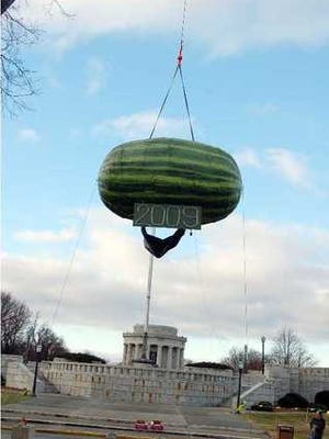 FILE - The giant watermelon is prepared to drop in Vincennes, Ind., for the 2008 New Year's Eve event.