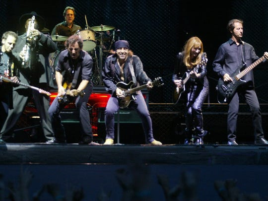 Members of the the E Street Band perform with Bruce Springsteen in 2003.