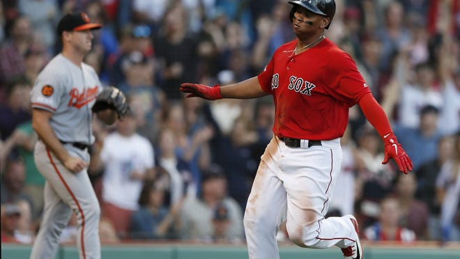 Boston's Rafael Devers was away from his usual group of practice partners, as he got in a workout at Boston College on Tuesday for undisclosed reasons.