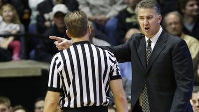 Purdue coach Matt Painter addresses an official during the Big Ten-opening victory over Minnesota.