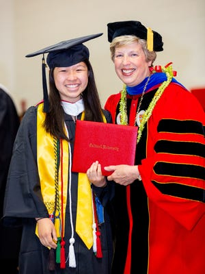 Michelle Eng of East Brunswick receives her Bachelor of Arts degree in biology from Caldwell University President Nancy Blattner, Ph.D, on May 20.